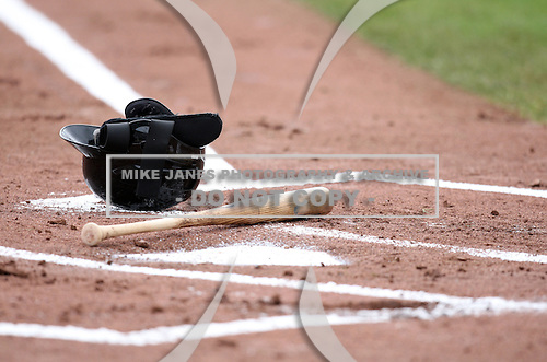 A helmet and bat lay on the ground after a strike out during a game between the Rochester Red Wings and Norfolk Tides at Frontier Field in Rochester, New York;  June 3, 2010.   Rochester defeated Norfolk by the score of 9-0.  Photo By Mike Janes/Four Seam Images