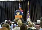 MARIA BRENNAN, of Wantagh, speaks at an event supporting extension of the NY Property Tax Cap. Brennan explained how prior to the tax cap her taxes increased 10% in one year. At the bi-partisan Press Conference at Knights of Columbus Hall, over a hundred area residents and officials, urged extending the property tax cap before the state legislative session ends on June 17. The NY Property Tax Cap is set to expire June 2016, but is legally linked to NYC rent-control regulations set to expire this month. Brennan also explained high taxes can make it harder for people to afford to volunteer. Brennan introduced the NYS governor at the event, and she is a member of CERT the Community Emergency Response Team, the Wantagh-Seaford Homeowners' Association, and other volunteer groups.