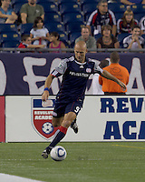 New England Revolution forward Ilija Stolica (9) crosses the ball. The New England Revolution tied Columbus Crew, 2-2, at Gillette Stadium on September 25, 2010.