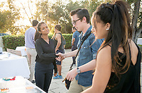 Occidental College students Ama Peiris '17 and Somer Greene '16 present their InternLA experiences working at Community Partners during the Career Development Center's Reverse Career Fair, Thorne Hall patio, Sept. 3, 2015.<br /> (Photo by Marc Campos, Occidental College Photographer)