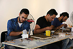 Palestinian artists make clay sculptures during a training workshop at Shababek for contemporary art center, in Gaza City, July 13, 2019. The training workshop funded by the Arab Fund for Arts and Culture (AFAC) aims to devolop the capabilities of young artists using contemporary tools and materials. Photo by Ashraf Amra
