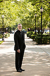 The Rev. Dennis H. Holtschneider, C.M., president of DePaul University, is seen in a portrait on DePaul's Lincoln Park campus quad Monday June 29, 2015. (DePaul University/Jeff Carrion)