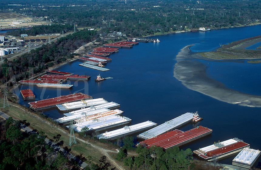 Aerial view of barges moored in the San Jacinto River upstream from the confluence of the Houston Ship Channel. Houston, Texas.