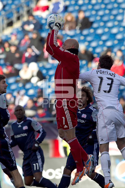 New England Revolution goalkeeper Matt Reis (1) rises above the crowd on a save. In a Major League Soccer (MLS) match, the New England Revolution defeated DC United, 2-1, at Gillette Stadium on March 26, 2011.