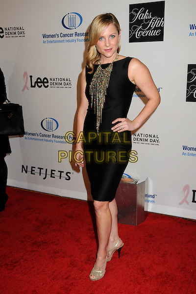JESSICA CAPSHAW.EIF's Women's Cancer Research Fund Benefit held at the Beverly Wilshire Hotel, Beverly Hills, California, USA..January 27th, 2010.full length sleeveless dress hand on hip black gold necklaces beads beaded.CAP/ADM/BP.©Byron Purvis/AdMedia/Capital Pictures.