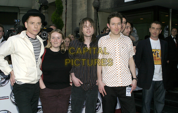 BELLE & SEBASTIAN.Nationwide Mercury Music Prize - Arrivals.Grosvenor House, London, W1 .September 7th, 2004.half length, music, band, stripes, dots.www.capitalpictures.com.sales@capitalpictures.com.© Capital Pictures.