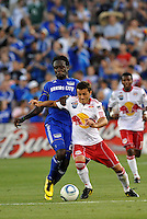 Sinisa Ubiparipovic, Kei Kamara (blue)..Kansas City were defeated 3-0 by New York Red Bulls at Community America Ballpark, Kansas City, Kansas.
