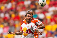Jonny Steele (22) of the New York Red Bulls and Ricardo Clark (13) of the Houston Dynamo. The New York Red Bulls defeated the Houston Dynamo 2-0 during a Major League Soccer (MLS) match at Red Bull Arena in Harrison, NJ, on June 30, 2013.