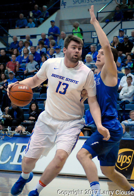 March 4, 2017:  Boise State forward, Nick Duncan #13, drives for the basket during the NCAA basketball game between the Boise State Broncos and the Air Force Academy Falcons, Clune Arena, U.S. Air Force Academy, Colorado Springs, Colorado.  Boise State defeats Air Force 98-70.