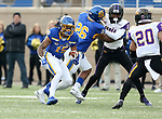BROOKINGS, SD - NOVEMBER 16: Cade Johnson #15 of the South Dakota State Jackrabbits looks for running room past Jevon Brekke #20 of the Northern Iowa Panthers during their game Saturday afternoon at Dana J. Dykhouse Stadium in Brookings, SD. (Photo by Dave Eggen/Inertia)