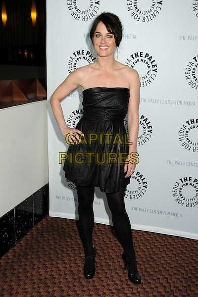 "ROBIN TUNNEY .The 26th Annual William S. Paley Television Festival presents ""The Mentalist"" held at Arclight Cinemas,  Hollywood, CA, USA, 17th April 2009..full length black strapless dress hand on hip tights patent shoes green.CAP/ADM/BP.©Byron Purvis/Admedia/Capital Pictures"