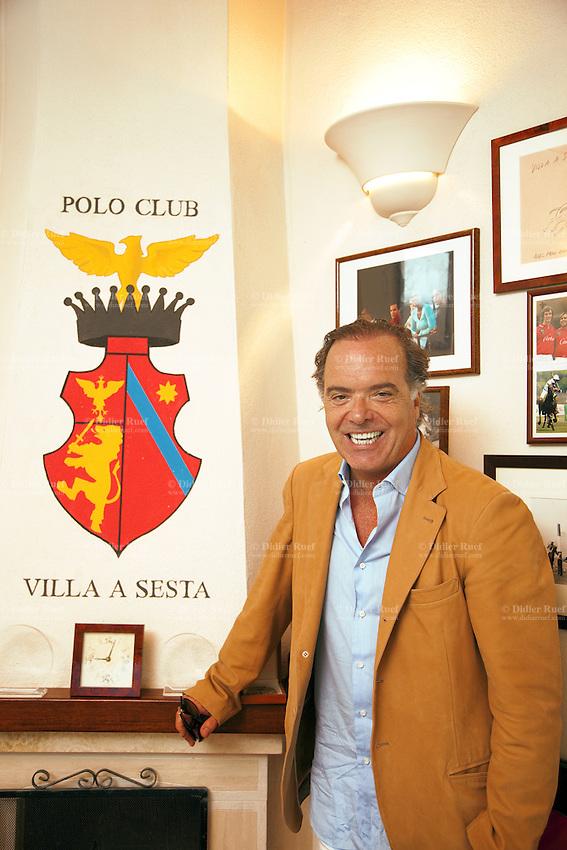 Italy. Tuscany. Polo Club Villa A Sesta is located near the village of Ripaltella and Pietraviva (Arezzo). Riccardo Tattoni stands in the club house of the Polo Club Villa A Sesta, which he is the owner. 17.09.10 © 2010 Didier Ruef