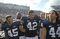 06 October 2012:  Penn State's P.J. Byers or Alex Butterworth(45), Gerald Hodges (6), Michael Mauti (42), coach Bill O'Brien, and Michael Fuhrman (44) sing the Penn State alma mater with the student section after the win.  The Penn State Nittany Lions defeated the Northwestern Wildcats 39-28 at Beaver Stadium in State College, PA.
