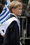 Greek Parade in New York City. A boy holding a Greek flag in the Greek Parade in New York City.