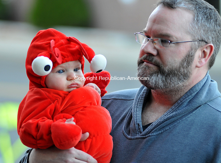 NAUGATUCK, CT 06 NOVEMBER 2011--110511JS01---Chris Varden of Portland carries his 6 month-old son Cooper, dressed as a lobster,  in the Fireighters Local 1219 and the American Legion Post #17 annual Halloween parade and party Saturday at the Naugatuck Fire Department. Varden and his family were staying with his wife's family in Naugatuck until their power is restored. More than 200 children came out for the event. <br /> Jim Shannon Republican-American