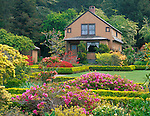 Shore Acres State Park, OR   <br /> The Garden House with azaleas and spring flowers in bloom in the formal gardens of the former Simpson Estate