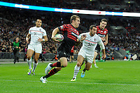 20131018 Copyright onEdition 2013©<br /> Free for editorial use image, please credit: onEdition<br /> <br /> Chris Wyles of Saracens runs in a try during the Heineken Cup match between Saracens and Stade Toulousain at Wembley Stadium on Friday 18th October 2013 (Photo by Rob Munro)<br /> <br /> For press contacts contact: Sam Feasey at brandRapport on M: +44 (0)7717 757114 E: SFeasey@brand-rapport.com<br /> <br /> If you require a higher resolution image or you have any other onEdition photographic enquiries, please contact onEdition on 0845 900 2 900 or email info@onEdition.com<br /> This image is copyright onEdition 2013©.<br /> This image has been supplied by onEdition and must be credited onEdition. The author is asserting his full Moral rights in relation to the publication of this image. Rights for onward transmission of any image or file is not granted or implied. Changing or deleting Copyright information is illegal as specified in the Copyright, Design and Patents Act 1988. If you are in any way unsure of your right to publish this image please contact onEdition on 0845 900 2 900 or email info@onEdition.com