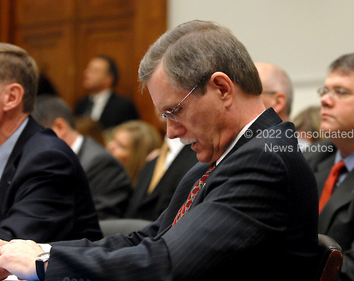 """Washington, DC - December 5, 2008 -- Ron Gettelfinger, President, United Auto Workers, looks over his notes prior to giving testimony before the United States House Financial Services Committee hearing """"On review of industry plans to stabilize the financial condition of the American automobile industry""""  in Washington, D.C. on Friday, December 5, 2008.  He was there with other automotive industry leaders to request $35 billion in loans from Congress to insure their respective company's survival..Credit: Ron Sachs / CNP"""