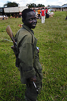 Amuka militia member Geoffrey is a 15-year-old guardian of internally displaced in Abaku Camp for the internally displaced. He mans a perimeter of the food distribution area, to keep the World Food Programme's work orderly at the camp for 4,800 people 42 kilometers east of Lira. (Rick D'Elia)Kalashnikov AK-47.