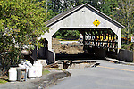 Quechee Covered Bridge after Tropical Storm Irene.  The bridge is still standing but road on both sides has washed away from the flooding.  August 29, 2011.