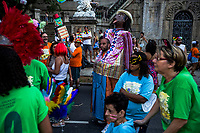 RIO DE JANEIRO, BRAZIL - FEBRUARY 23, 2014: (Centre) Samy das Chagas, a visual artist and mental health patient, walks with the parade during the annual T&aacute; Pirando, Pirado, Pirou! carnival street parade near the Instituto Philippe Pinel psychiatric hospital on February 23, 2014 in Rio De Janeiro, Brazil. It looks like any of the other 450 or so street parties, locally called &ldquo;carnival blocks,&rdquo; that parade through Rio de Janeiro during the raucous pre-Lenten festivities that draw hundreds of thousands to the city each year. What makes this party different are its performers and organizers: psychiatric patients and their doctors, therapists, family members, neighbors and passers-by. The group, called T&aacute; Pirando, Pirado, Pirou!, which roughly translates as &ldquo;We&rsquo;re freaking out, we already freaked out!&rdquo;, began ten years ago when Brazil was in the process of dismantling its century-old system of mental asylums. A law passed in 2001 called for long-term outpatient psychiatric care to be offered primarily in community clinics. The number of such clinics increased more than fivefold in the following decade, while the number of asylum beds for psychiatric patients dropped 40 percent nationwide.<br /> <br /> Daniel Berehulak for The New York Times