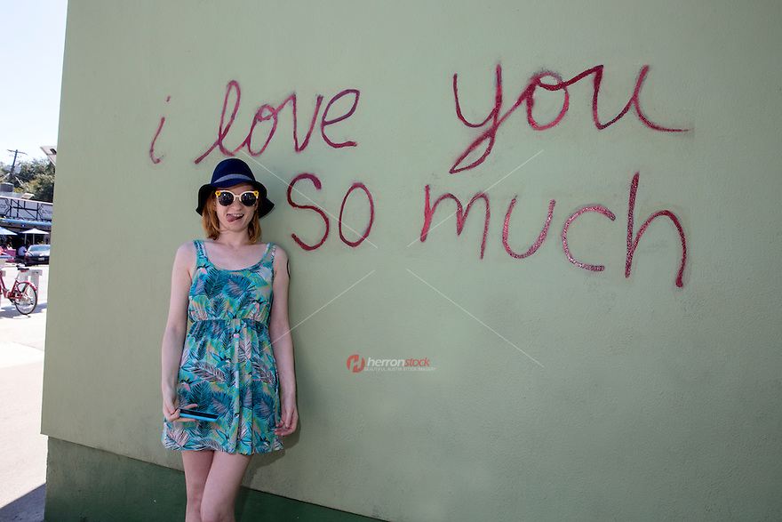 "Taking a picture in front of the famous ""I love you so much"" mural in South Congress is a fun thing to do and a famous tourist landmark - Stock Image."