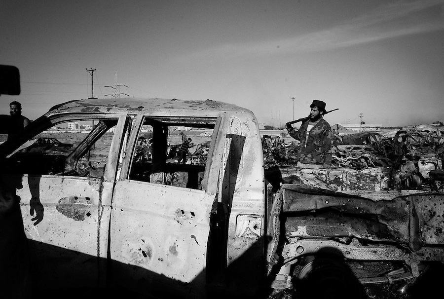 Aftermath of NATO strike on the convoy of Gaddafi loyalists that attempted to leave Sirte, Libya, October 20, 2011. The death of Muammar Gaddafi brings closure to an 8 month uprising turned revolutionary war.