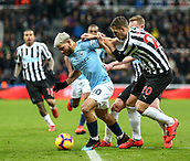29th January 2019, St James Park, Newcastle upon Tyne, England; EPL Premier League football, Newcastle United versus Manchester City; Sergio Aguero of Manchester City holds off a challenge from Florian Lejeune of Newcastle United