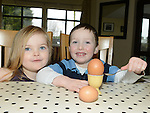 Joules Jackson and Oisín McKenna grandchildren of Lynn McDonnell Oulster Lane pictured with the enormous egg laid by one of her hens. Photo:Colin Bell/pressphotos.ie