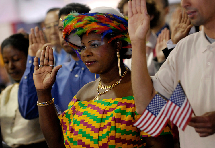 Ghanaian Mary Gyimah is sworn-in as a U.S. Citizen during  a U.S. Citizenship and Immigration Services naturalization ceremony on the National Mall at the Public Service Recognition Week event tent.