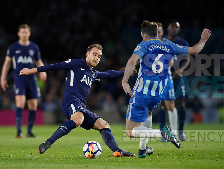 Christian Eriksen of Tottenham tackled by Dale Stephens of Brighton during the premier league match at the Amex Stadium, London. Picture date 17th April 2018. Picture credit should read: David Klein/Sportimage