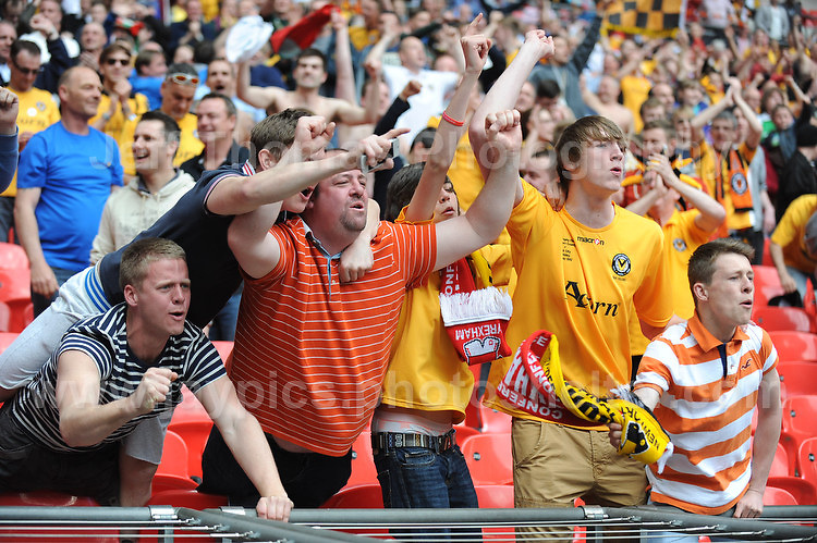 Newport County supporters are ecstatic after watching their team win promotion during the Newport County v Wrexham Blue Sq. Bet Premier league playoff final at Wembley Stadium, London, England Sunday 5th May 2013. Credit for pictures to Jeff Thomas Photography - www.jaypics.photoshelter.com - 07837 386244 - Use of images are restricted without prior permission of the copyright owner Jeff Thomas Photography.