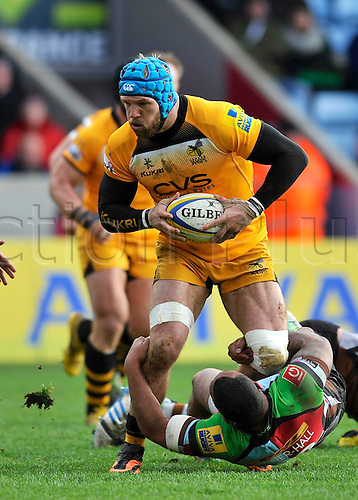 09.02.2014. Twickenham, London, England.   Rugby Union. Aviva Premiership Rugby. James Haskell of London Wasps tackled during the Aviva Premiership match between Harlequins and London Wasps at Twickenham Stoop on February 9, 2014 in Twickenham, England.