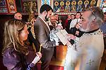A blessing of a newborn after liturgy at St. Sava Church, Jackson, Calif.
