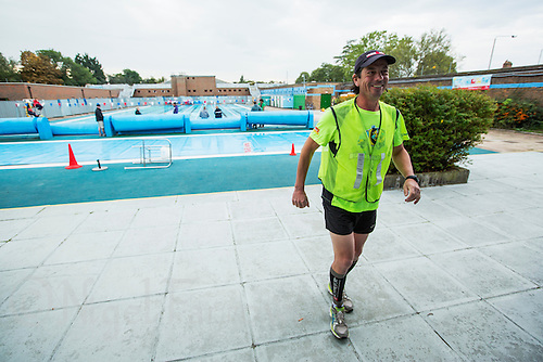 28 SEP 2013 - LONDON, GBR - Paul Gosney walks from the poolside at Charlton Lido in London, Great Britain to start the 77 mile run for the Enduroman 2013 Lands End to London to Dover ultra triathlon (PHOTO COPYRIGHT © 2013 NIGEL FARROW, ALL RIGHTS RESERVED)