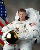 Houston, TX - (FILE) -- September 22, 2006 file photo of Astronaut Steven R. Swanson, mission specialist, STS-119, scheduled for launch no earlier than February 27, 2009.  Space shuttle Discovery will deliver the International Space Station's fourth and final set of solar arrays, completing the station's backbone, or truss structure.  The arrays will provide enough electricity to power science experiments and support the station's expanded crew of six. Altogether, the station's arrays can generate about 120 kilowatts of usable electricity -- enough to provide about 42 2,800-square-foot homes with power. The 14-day flight will include four spacewalks, lasting about 6.5 hours each, to help install the S6 truss segment to the right side of the station. STS-119 is the 125th space shuttle flight, the 28th flight to the station, the 36th flight of Discovery, and the first flight in 2009..Credit: NASA via CNP