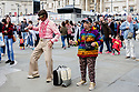 A man and a woman in colourful costume dance to the rock band at the 10th Japanese Matsuri Festival, Trafalgar Square, London.