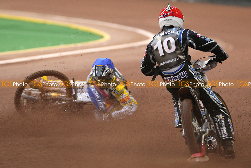 Heat 4: Hans Andersen (blue) crashes out as Andreas Jonsson (red) passes - The FIM Individual World Championship British Speedway Grand Prix at The Millennium Stadium, Cardiff - 28/06/08 - MANDATORY CREDIT: Rob Newell/TGSPHOTO