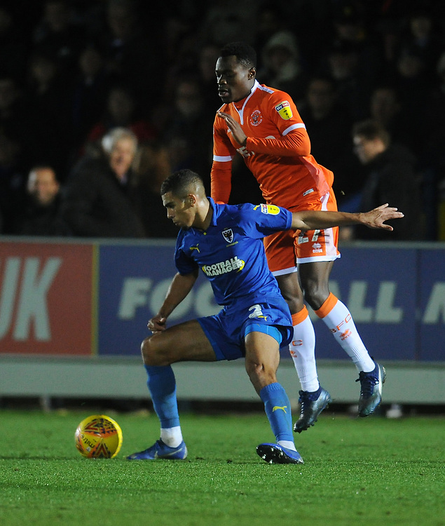 AFC Wimbledon's Tennai Watson under pressure from Blackpool's Marc Bola<br /> <br /> Photographer Kevin Barnes/CameraSport<br /> <br /> The EFL Sky Bet League One - AFC Wimbledon v Blackpool - Saturday 29th December 2018 - Kingsmeadow Stadium - London<br /> <br /> World Copyright © 2018 CameraSport. All rights reserved. 43 Linden Ave. Countesthorpe. Leicester. England. LE8 5PG - Tel: +44 (0) 116 277 4147 - admin@camerasport.com - www.camerasport.com