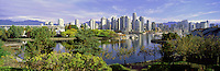 "City of Vancouver Skyline and Downtown at Yaletown and ""False Creek"", BC, British Columbia, Canada, in Autumn / Fall.  Granville Island is in the left foreground, and the North Shore Mountains (Coast Mountains) rise above the City. - Panoramic View"