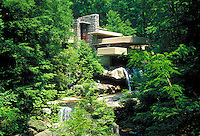 The house built for storeowner E. J. Kauffman by architect Frank Lloyd Wright is located in trees and over a stream. Pittsburgh Pennsylvania United States Fallingwater.