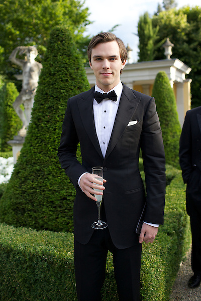 Nick Hoult wears Dolce & Gabbana black tie at Elton John's White Tie and Tiara Ball