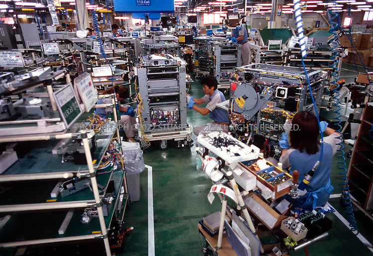 8/5/02--Arakawaoki, Japan..Employees at Canon's Ami Plant assemble color copy machines...All photographs ©2003 Stuart Isett.All rights reserved.This image may not be reproduced without expressed written permission from Stuart Isett.
