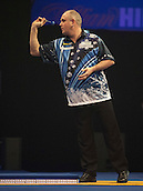 21.12.2014.  London, England.  William Hill World Darts Championship.  Ian White (15) [ENG] in action during his game with qualifier John Michael [GRE].