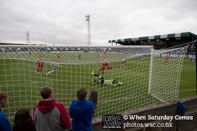 Barrow AFC 0 Newport County 3, 15/09/2012. Furness Building Society Stadium, Football Conference. Home supporters watching the action from the terracing behind the goal at Barrow AFC's Furness Building Society Stadium during the Barrow (white shirts) v Newport County Conference National Fixture. Newport County eventually won the match by 3-0, watched by 802 spectators. Both Barrow and Newport County from Wales were former members of the Football League in England. Photo by Colin McPherson.