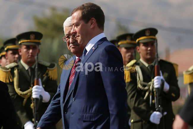 Palestinian President Mahmud Abbas and Russian Prime Minister Dmitry Medvedev review the honour guard ahead of a meeting in the West Bank city of Jericho, on November 11, 2016. Photo by Shadi Hatem