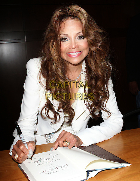 La Toya Jackson.book signing for 'Starting Over' held at Barnes & Noble at The Grove, Los Angeles, California, USA 28th June 2011.half length white jacket trousers diamond necklace signing autograph book holding pen.CAP/ADM/KB.©Kevan Brooks/AdMedia/Capital Pictures.