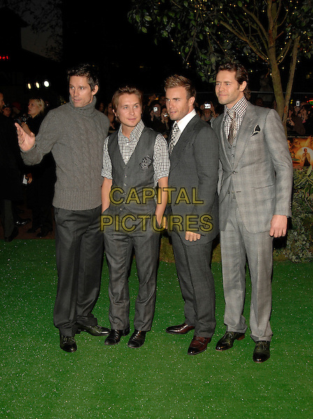 "TAKE THAT - JASON THOMAS ORANGE, MARK OWEN, GARY BARLOW & HOWARD DONALD.""Stardust"" European film premiere.Odeon, Leicester Square.3rd October 2007 London, England.full length grey gray suits sweater jumper waistcoat hand waving hands in pockets .CAP/PL.©Phil Loftus/Capital Pictures"