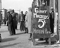 """1930's street scene featuring """"Giant Malteds 5 cents"""" sign.  (Photo by bcpix.com)"""