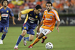 25 July 2007:  Oscar Rojas (4) of Club America cuts the ball around Dwayne De Rosario (14) of the Dynamo.  Club America was defeated by the Houston Dynamo 0-1 at Robertson Stadium in Houston, Texas, in a first round SuperLiga 2007 match.